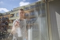 Man cleaning window at home - PhotoDune Item for Sale