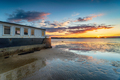 Sunset over an old boat on Bramble Bush Bay at Studland in Poole Harbour - PhotoDune Item for Sale