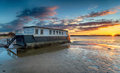 Dramatic sunset over a houseboat in Bramble Bush Bay - PhotoDune Item for Sale