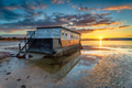Stunning sunset over an old houseboat moored at Bramble Bush Bay - PhotoDune Item for Sale