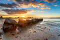 Beautiful sunset over old WWII tank traps in Bramble Bush Bay - PhotoDune Item for Sale