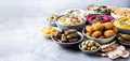 Mediterranean appetizer concept. Arabic traditional cuisine. Middle Eastern meze with pita, olives - PhotoDune Item for Sale