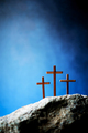 Three wooden cross on Calvary hill, blue background. Crucifixion, resurrection of Jesus Christ - PhotoDune Item for Sale