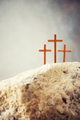 Three wooden cross on Calvary hill, grey background. Crucifixion, resurrection of Jesus Christ - PhotoDune Item for Sale