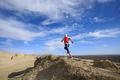 Woman trail runner cross country running  on sand desert dunes - PhotoDune Item for Sale
