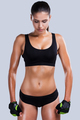 Energy inside her. Beautiful young sporty woman with perfect body standing against grey background - PhotoDune Item for Sale