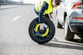 Man changing car wheel on the roadside - PhotoDune Item for Sale