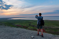Back view young male hiker looks at sea and horizon - PhotoDune Item for Sale