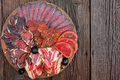 Close up of assorted sliced dry-cured meat on the wooden plate background - PhotoDune Item for Sale