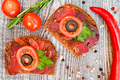 Close up of sliced dry-cured meat on the wooden background - PhotoDune Item for Sale