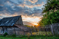 Sunset over the house and green trees in the countryside - PhotoDune Item for Sale