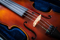 A close up of a syphony violin set against a black background - PhotoDune Item for Sale