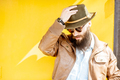 Portrait of a stylish man on the colorful background - PhotoDune Item for Sale