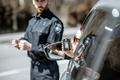 Policeman checking woman driver for alcohol intoxication - PhotoDune Item for Sale