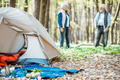 Campsite with senior couple in the forest - PhotoDune Item for Sale