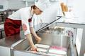 Salesman putting ice cream into the refrigerator - PhotoDune Item for Sale