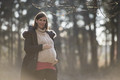 Pregnant young woman in a misty winter landscape - PhotoDune Item for Sale