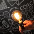 Businessman holding lightbulb in hand - PhotoDune Item for Sale