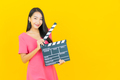 Portrait beautiful young asian woman smile with movie slate plate cutting - PhotoDune Item for Sale