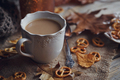 Autumn leaves, hot steaming cup of coffee and a warm scarf - PhotoDune Item for Sale