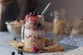 Layered dessert with muesli, yogurt, banana and berries in glass mason jar - PhotoDune Item for Sale