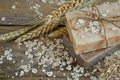 Natural handmade soap, oat flakes and wheat ears on wooden background - PhotoDune Item for Sale