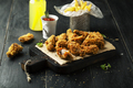 Fried wings with ketchup, sauce and lemonade on a wooden board - PhotoDune Item for Sale