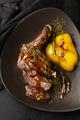 Roasted steak in frying pan on dark background - PhotoDune Item for Sale
