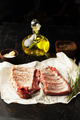 Raw pork ribs with spices, salt and rosemary on dark wooden background - PhotoDune Item for Sale