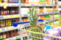 Part of shopping Grocery cart at a colorful supermarket filled up with food products - PhotoDune Item for Sale
