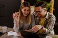 Smiling millennial husband and wife count taxes house expenditures pay bills on internet. - PhotoDune Item for Sale