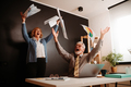 The older couple celebrates success in business by throwing papers around the home office. - PhotoDune Item for Sale