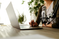 Cropped shot of a female typing on laptop. Businesswoman using laptop while working from home. - PhotoDune Item for Sale