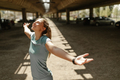 woman in sportswear enjoying after running outside. Healthy lifestyle, smiling with closed eyes. - PhotoDune Item for Sale