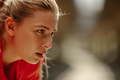 Close up photo of athletic blonde woman sweating taking a break from workout. - PhotoDune Item for Sale