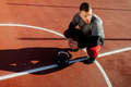 Athletic young man working out outdoors. Muscular male adult exercising with kettle bells. - PhotoDune Item for Sale