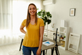 Portrait of young woman, standing in office, posing and looking at camera. - PhotoDune Item for Sale