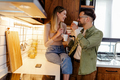 Blissful couple drinking coffee in stylish kitchen. - PhotoDune Item for Sale