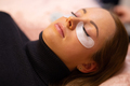 Woman With Cotton Pads Lying During Eyelash Extension Treatment - PhotoDune Item for Sale