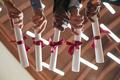 College graduates holding diplomas close up - PhotoDune Item for Sale
