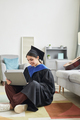 College graduate using laptop at home - PhotoDune Item for Sale