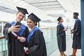 College graduates taking selfie at celebration - PhotoDune Item for Sale