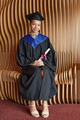 Young mixed race woman in graduation gown - PhotoDune Item for Sale