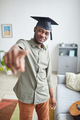 College graduate pointing at camera - PhotoDune Item for Sale