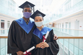 Two young people wearing masks at graduation - PhotoDune Item for Sale