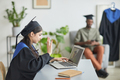 College graduate waving to video chat - PhotoDune Item for Sale