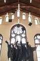Graduates throwing caps in air indoors - PhotoDune Item for Sale