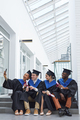 Diverse group of college graduates taking selfie outdoors - PhotoDune Item for Sale