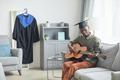 School graduate playing guitar - PhotoDune Item for Sale