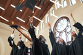 Graduates throwing hats in air - PhotoDune Item for Sale